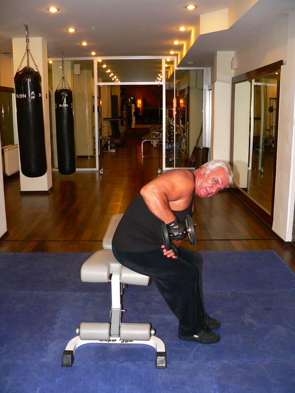 Seated Bent Over One Arm Dumbbell Triceps Kick Back