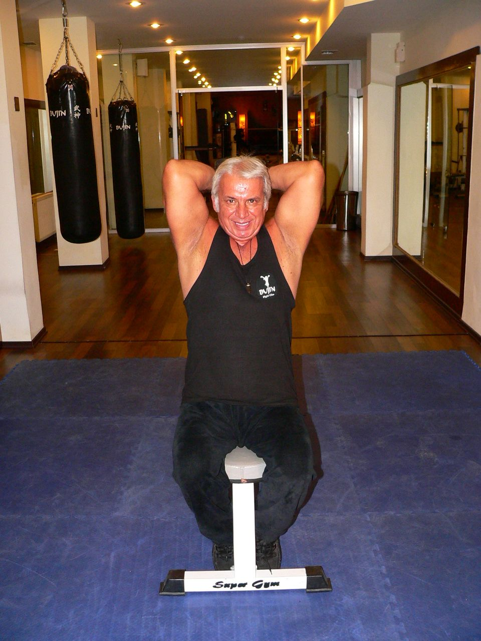 Seated  Two Arm Dumbbell Triceps Press