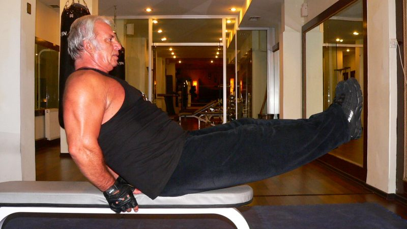 Seated Flat Bench Leg Pull – In