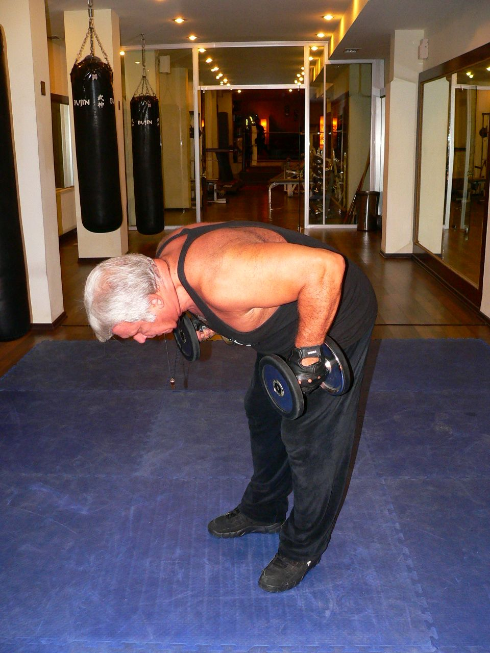 Standing Bent-Over Two-Arm Dumbbell Triceps Kick Back