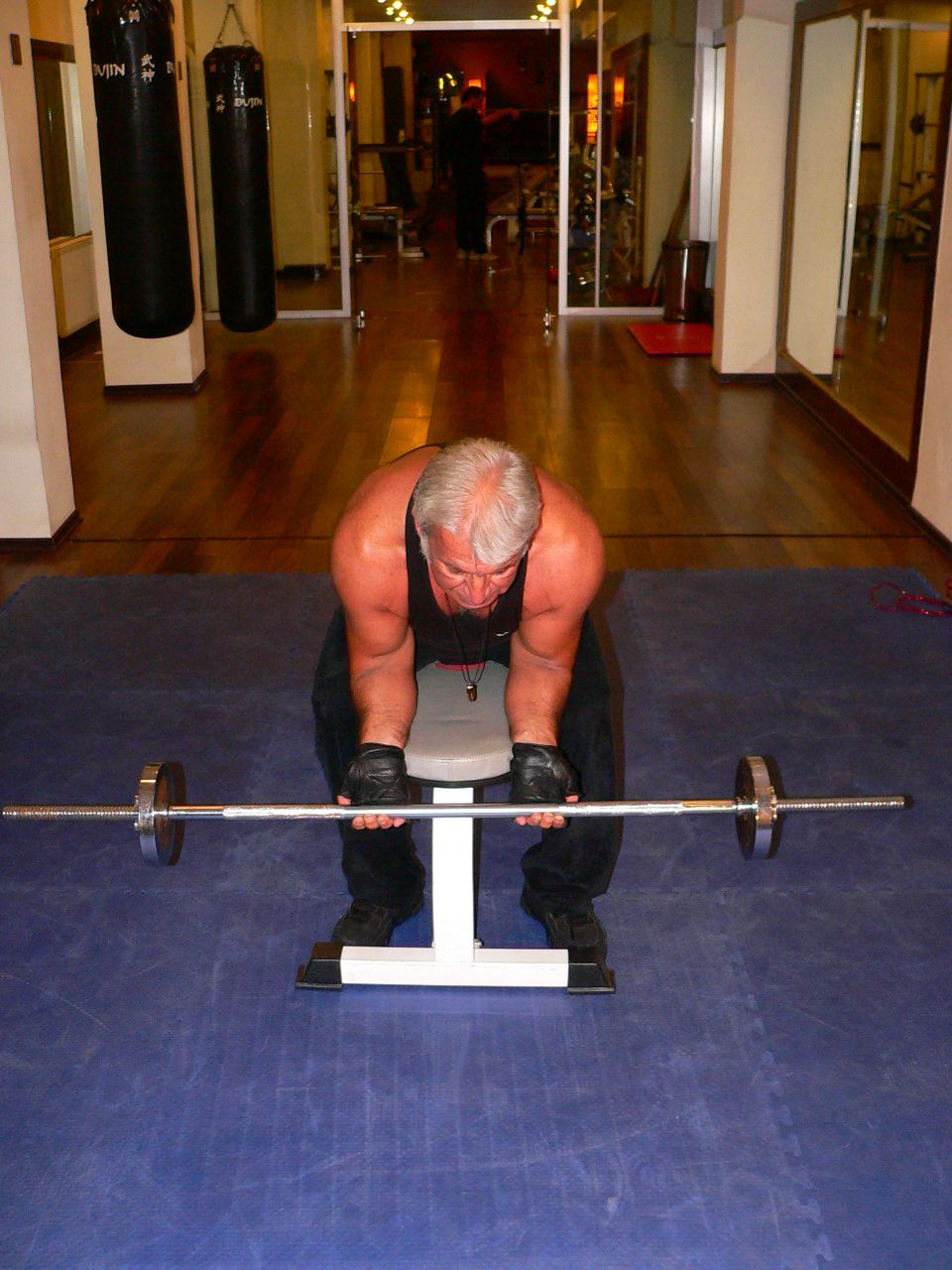 Seated Barbell Wrist Curl On The Bench
